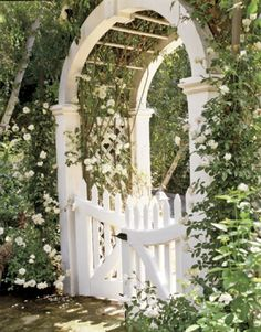 Painted gate with rose arch above