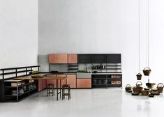 Patricia Urquiola's Salinas kitchen system for Boffi hides wires and pipes.
