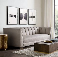 RH Modern's Paxton Fabric Sofa:Vertical channel stitching adds visual and tactile depth to our collection's rich upholstery. Inspired by 1970s postmodern design, the low-sitting frame features a high back, plush bench cushion and sheltering arms.