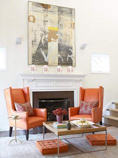 A Splash of Style: upholstering the classic wing back chairs in orange leather is an unexpected, yet perfect, choice.