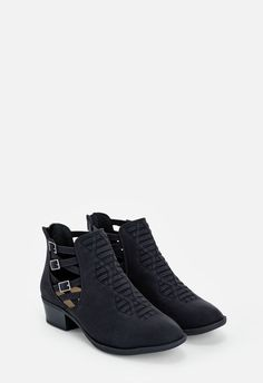 A faux leather bootie with a Cuban heel and dual side woven accents.  Now available in wide width....