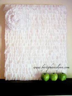 The ruffled backdrop is made from Crepe paper....only instead of that flower...a heart!