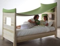 """What a fun """"tent"""" idea for a bed!"""