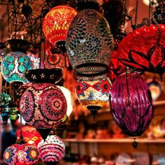Moroccan-inspired lighting  (I love all the bright colors and varied patterns!!)