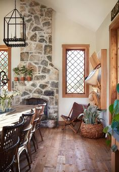 """(The window!!) The fireplace might be one of my favorite features. The stone ties in that European farmhouse look, and I'm not going to lie, Chip was right, I really love the look of this fireplace with the added """"hips,"""" as he calls them."""