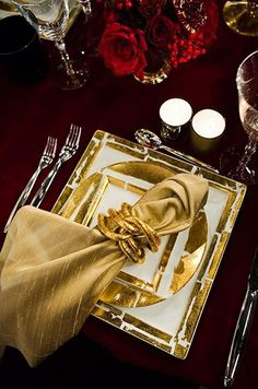 A luxurious gold holiday dinner napkin is styled with a chic holder for added elegance. Christmas Table Settings, Christmas Tablescapes, Holiday Tables, Christmas Decorations, Holiday Decor, Elegant Table Settings, Beautiful Table Settings, Dinner Napkins, Dinner Table