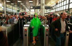 A man in costume passes a ticket control gate in the train station during Carnival in Cadiz, Spain on February 20, 2012. (Marcelo del Pozo/Reuters)