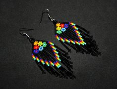 Size: The height/dangle is approx. 2.75 The Width at the widest point is approx. 1.25 ***Every order and customer is treated with the highest regard. Please see our review section here: https://www.etsy.com/your/shops/BiuluArtisanBoutique/reviews?ref=shop_info Item Description: - These earrings feature a a black background and bright contrasting flower patterns. - Want something changed? Feel free to request any color pattern youd like. - A design f...