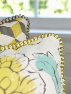 Cushions made with fabrics from MAHARANI collection Osborne & Little www.osborneandlittle.com