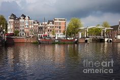 Amsterdam skyline, houses by the Amstel river and bridge on Nieuwe Herengracht, Netherlands, North Holland.