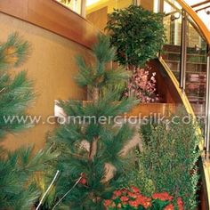Commercial Silk Int'l installed the artificial landscape, successfully extending the northwoods theme to the new addition. The tri-tier planter was filled with fake Birch branches, logs, and trees, creating a two-story focus that accentuated the height of the facility. All artificial trees and plants were manufactured with Inherently Fire Retardant foliage and passed muster with state fire codes. Last but not least, the project came in under budget, once again delighting hospital…