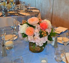 Periwinkle peach and cream wedding centrepiece. For more inspiration check out our 2015 wedding colours board https://www.pinterest.com/EzeEvents/10-wedding-colour-palettes-we-love-for-2015/