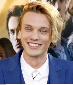 Jamie Campbell Bower smiles on the red carpet at the 'Mortal ...