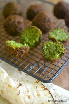 The Best Falafel is crispy on the outside, a brilliant emerald green on the inside, with tons of flavor and a great fluffy texture! This classic vegan snack is one of my all time favorites! #meatlessmonday #vegan #vegetarian #recipe #Mediterraneandiet #middleeastern #healthyappetizer #healthydinner #chickpeas #veggieburgers