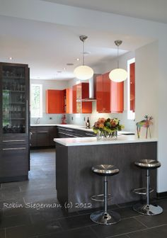 Love how orange puntuates and enlivens this kitchen! #RenovationBootcamp.com