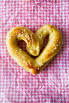 Heart Shaped Soft and Chewy Buttered Pretzels. This recipe is the best and it includes step by step pictures of how to shape them! | My Name Is Snickerdoodle