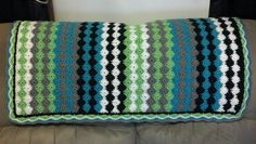 Blanket with nice shell edging. Baby M Blanket pattern by Vicky Howell