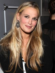Model Molly Sims keeps her golden blonde highlights from looking over-saturated with lots of lowlights—ask your colorist to blend a darker shade close to your natural base with a brighter blonde for a natural contrast and less upkeep.Photo Credit: Getty Images, courtesy of iVillage via StyleList