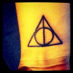 Harry Potter Tattoo - looks quite rad.   The sign of the Deathly Hallows represents all three objects symbolically: the Wand, the Stone, and the Cloak.
