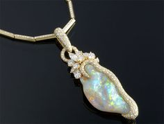"The brilliance of opals and diamonds distinguish this Henry Dunay necklace  The opal weighs an impressive 34.20 carats  9.68 carats of white diamonds are set in the chain and the pendant  This necklace is crafted of 18K yellow gold  20"" length"