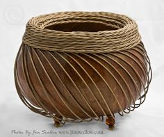 Jim Swallow: Natural gourd in brown and reed weaving with bead legs. 7 inches high by 8 inches wide