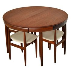 "Teak dining set by Hans Olsen for Frem Rojle. Hide away chairs store within the table skirt. ""Made in Denmark"""