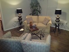 14 x 13 living room.  Smaller scale furniture makes the room look bigger.