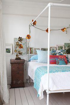 rustic furniture and artwork decor inside of bohemian bedroom interior