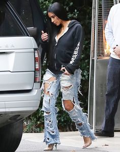 Kim Kardashian West Rocks Shredded Jeans for First Street Style Appearance in Months from InStyle.com
