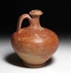 A Roman Terracotta Spouted Jug