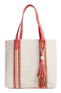 Textured straps and a faux-leather finish extend the everyday sophistication of this spacious tote accented with a vintage tassel detail.
