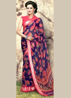 Ravishing attire to enhance your beauty. Be your own style diva with this multi colour georgette printed saree. This lovely attire is looking extra beautiful with embelishment of print work. Comes with matching blouse. (Slight variation in color, fabric & work is possible. Model images are only representative.)