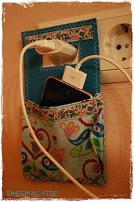 If you don't like the lotion bottle version of the recharger holder, how about you make a quilty version? Use something like Timtex or Peltex interfacing to stiffen the back, and be sure your pocket is gusseted!