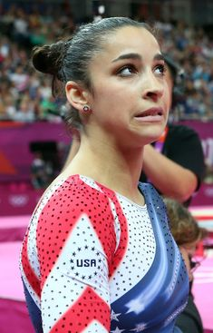 Aly Raisman of the United States reacts after she competes on the beam during the Artistic Gymnastics Women's Beam final on Day 11 of the London 2012 Olympic Games at North Greenwich Arena on August 7 2012 in London England. Gymnastics Problems, Acrobatic Gymnastics, Gymnastics Pictures, Sport Gymnastics, Artistic Gymnastics, Olympic Gymnastics, Gymnastics Posters, Olympic Champion, Olympic Team