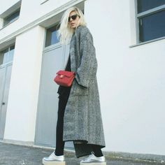 Longline oversized coat with black knit and pants, platform shoes, and Chanel crossbody bag.