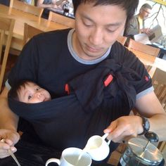 A sakura bloom baby sling keeps Dad's hands free.