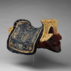 Saddle: Date: 17th–18th century Culture: Chinese for the Tibetan market, Medium: Iron, gold, silver, wood, coral, ivory, silk, hair, tin, pigments, leather