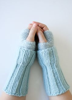 These Cuffed Hand Warmers tickle my fancy with their trompe l'oeil  cuffs. As if the sleeves of a beautiful, cozy sweater were hanging down  past your wrists, the effect is a refined kind of slouchy.  I love also the textural play of two yarns who, once strangers to each  other, come together here in a beautiful friendship! A similar icy blue  color may have been their conversation starter, but as the two yarns got  chatting, they realized that what makes each different is also what  makes…