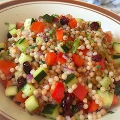 Pearl Couscous Salad ~ An economical take-off of a pricey deli salad - couscous (orzo), lentils, tomatoes, cucumber, red onion, green onion, red bell pepper, parsley, dried cranberries & golden raisins. Dressing: olive oil, fresh lemon juice, honey, salt & pepper. Refrigerate overnight. **UPDATE: Made this & it was very good. Next time will add broccoli florets for some crunch.