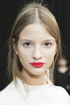 A fierce red lip instantly dresses up a completely bare face. Use lip brush and concealer to clean  mistakes and accentuate the lip line.  Read more:http://www.dailymakeover.com/trends/makeup/red-lipstick-looks/#ixzz3Khu1rZp9