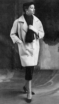 1963 Suzy Parker in white wool coat buttoned low with a waist-deep collar by Balenciaga, photo by John Rawlings