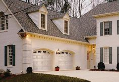 Clopay Classic Collection Premium Series Garage Door features a delightful double take on this home. Double Garage Door, Garage Door Panels, Modern Garage Doors, Residential Garage Doors, Commercial Garage Doors, Garage Door Makeover, Arched Windows, House Roof, Classic Collection