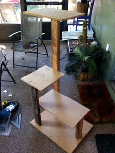 DIY Network shows you how to make a custom cat tower using sisal rope, carpet and plywood.
