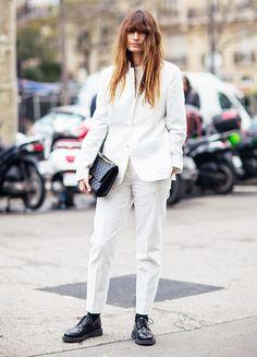 Caroline de Maigret wears a menswear-inspired white suit with black oxfords