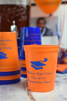 Orange stadium cups printed with Royal Blue imprint, 2239 cap design, and three lines of text in Married lettering style