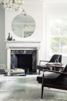 White marble fireplace with black marble surround