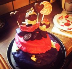 The candy cake : fresh baked cake , candies, buttercream, marshmallows, chocolate, oreo cookies, lollipops, banana liqeuor