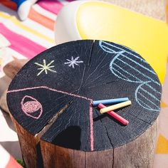 + #DIY idea - paint the top of a tree stump with chalkboard paint. It's an art project the whole family can enjoy! +