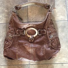 Black Rivet shoulder bag Adorable Black Rivet brown distressed  look faux leather larger hobo with silver accents.  Great condition!!  Lots of cute detail on this purse. Black Rivet Bags Shoulder Bags