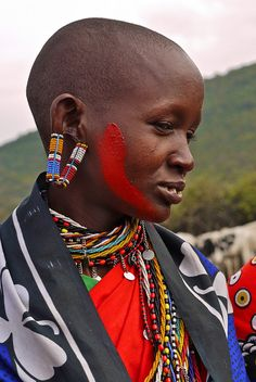 Africa | Maasai woman with stretched earlobes | ©  Rita Willaert